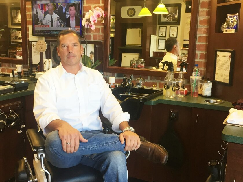Scott McDaniel at V's Barbershop, his second location in Carlsbad. Photo by Kristina Houck