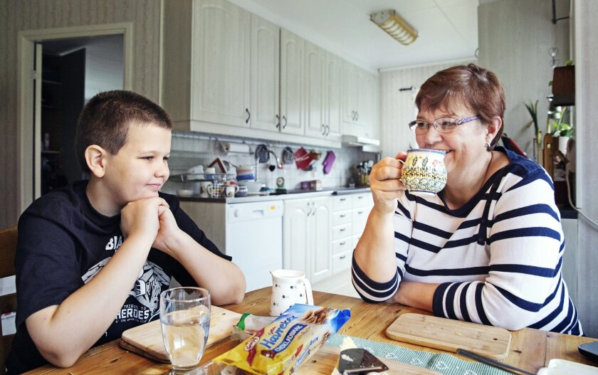 Gabrielle Tikman, right, a surgical nurse, with her son Rasmus at her home in Gothenburg, Sweden, Nov. 5, 2015. A trial, that Tikman is part of, in the city of Gothenburg mandates a six-hour work day and is testing whether it can reduce absenteeism and increase productivity. (Magnus Laupa/The New Y