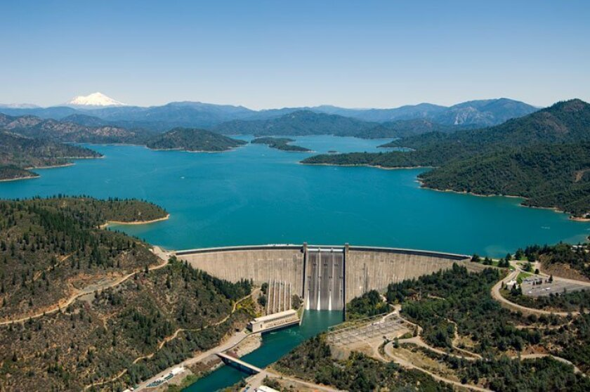 Shasta Dam viewed from the air, with the reservoir nearly full.