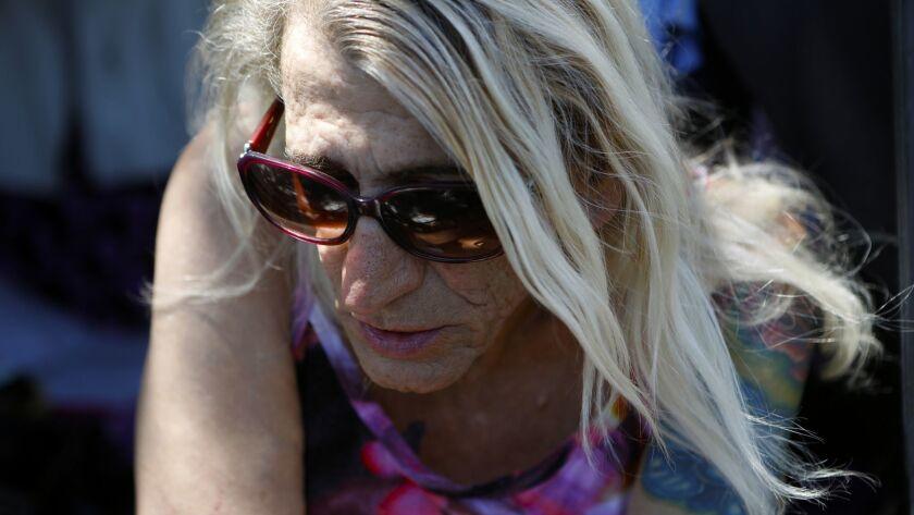 SAN GABRIEL VALLEY, CA JUNE 28, 2018: Andrea Colucci, 70, sits in the doorway of her van in the S