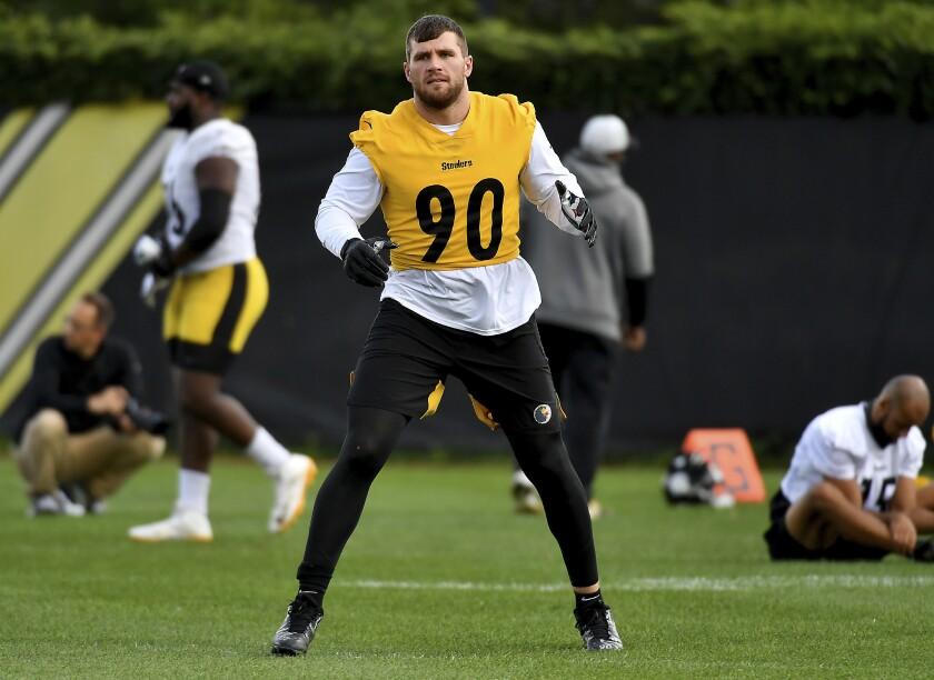 Pittsburgh Steelers linebacker T.J. Watt warms up during the NFL football team's practice Thursday, Sept.. 9, 2021, in Pittsburgh. (Matt Freed/Pittsburgh Post-Gazette via AP)