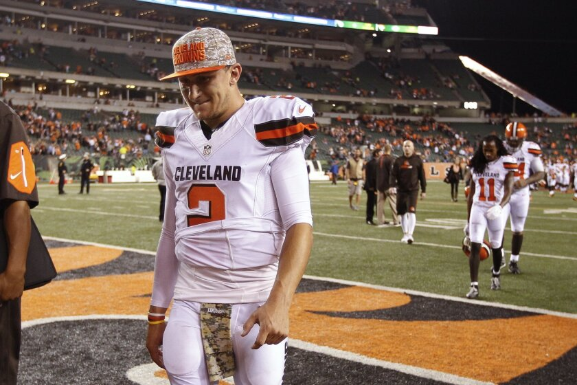FILE- In this Nov. 5, 2015, file photo, Cleveland Browns quarterback Johnny Manziel walks off the field after the Browns lost 31-10 to the Cincinnati Bengals during an NFL football game in Cincinnati. The Browns said Tuesday, Feb. 9, 2016, that Manziel was diagnosed with a concussion late in the se