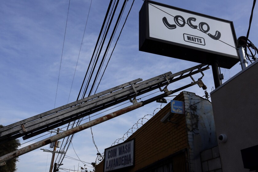 A business sign is installed for Local, the new restaurant in Watts by chefs Roy Choi and Daniel Patterson.