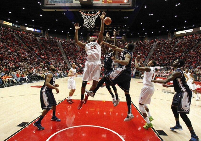 Josh Davis tries for a rebound as SDSU took on Nevada at Viejas Arena Saturday night.