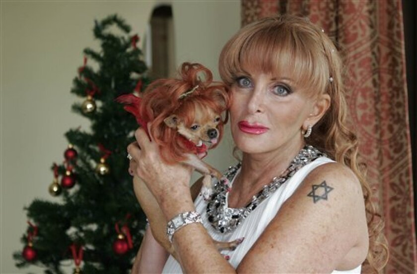 This undated image provided by Famous Chihuahuas, shows Gail Posner and Chonchita, one of Posner's three chihuahuas that were left a $3 million trust when Posner died. Posner's only surviving child, 46-year-old Brett Carr, is challenging her will contending that Posner was coerced into changing her