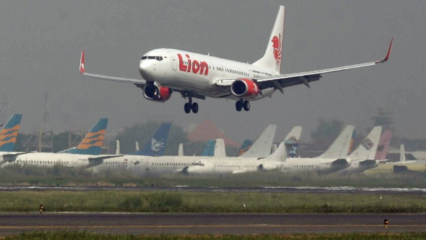 FILE - In this May 12, 2012 file photo, a Lion Air passenger jet takes off from Juanda International