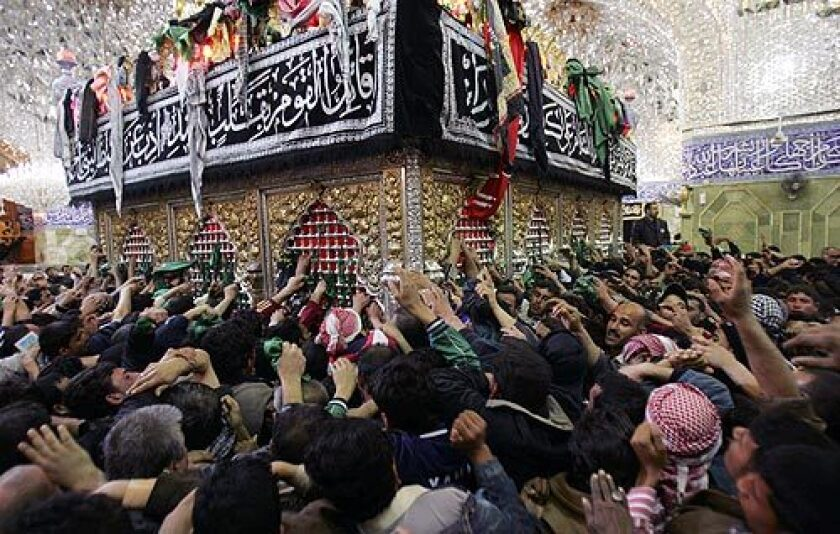 Shiite pilgrims throng a holy site in Karbala, Iraq, on Saturday. Shiites are making their annual pilgrimage to Karbala to mark the end of 40 days of mourning following the anniversary of the 7th century death of Imam Hussein, a grandson of the Prophet Mohammed. More photos >>>