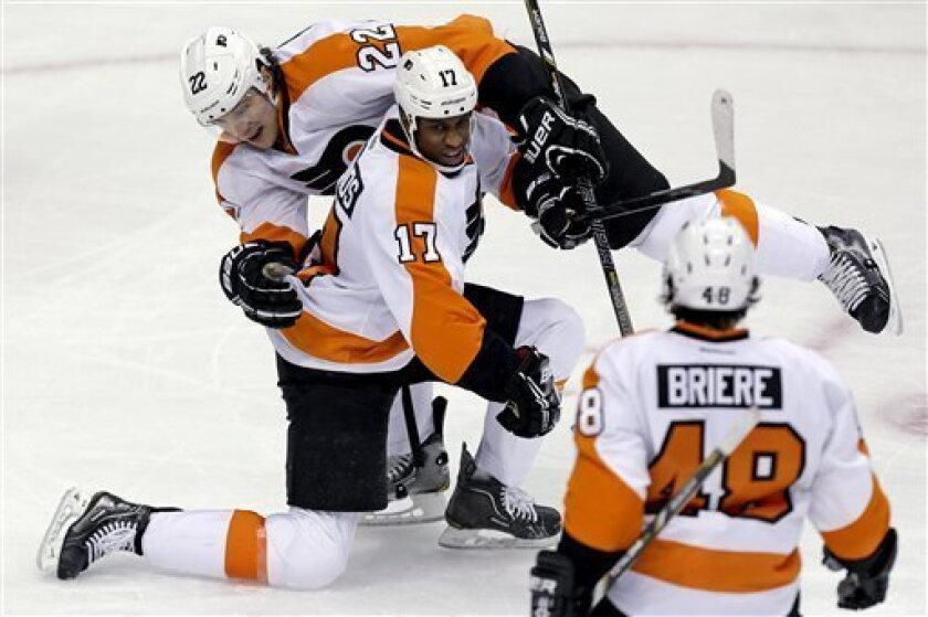 Philadelphia Flyers right wing Wayne Simmonds (17) celebrates with defenseman Luke Schenn (22) and center Danny Briere (48) after scoring during the first period of an NHL hockey game against the Pittsburgh Penguins in Pittsburgh, Wednesday, Feb. 20, 2013. (AP Photo/Gene J. Puskar)