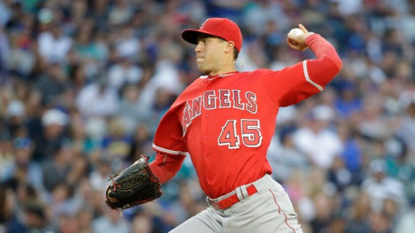 Tyler Skaggs pitches during the Angels' 8-6 loss to the Seattle Mariners on Aug. 6 in Seattle.