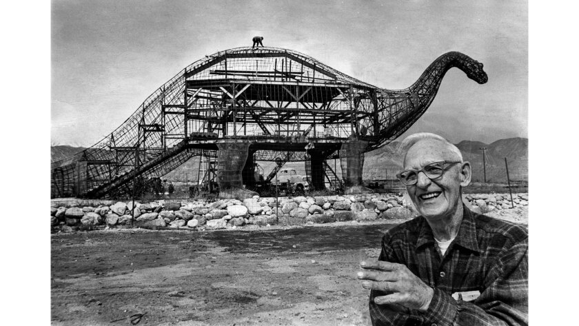 March 23, 1970: Sculptor Claude K. Bell with his 45-foot-tall, 150-foot-long brontosaurus in Cabazon.