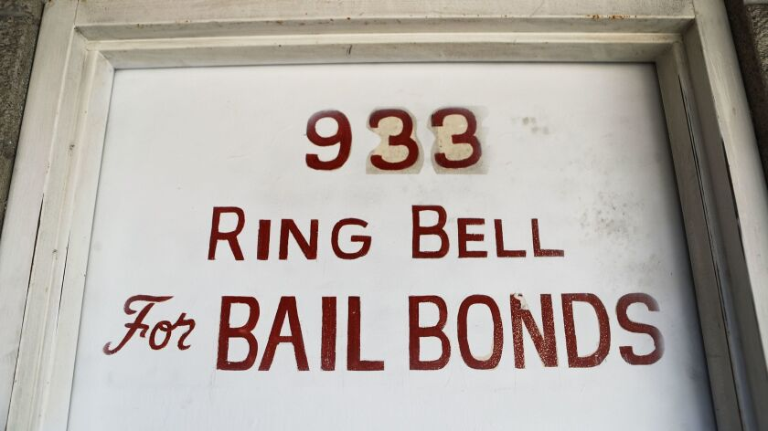 A sign advertises a bail bond company in Los Angeles. In the wake of a new law to make California the first state to abolish bail for suspects awaiting trial, the bail industry is seeking to overturn the law by a ballot referendum.