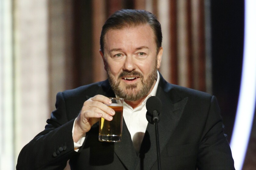 Ricky Gervais takes a drink while hosting the Golden Globe Awards in 2020.