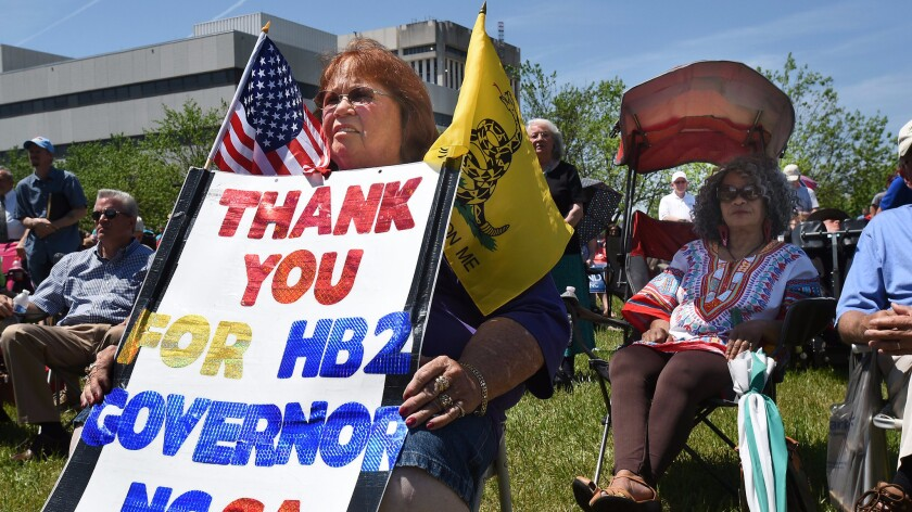 Lee Churchill shows her support for House Bill 2 during a rally behind the North Carolina General Assembly building in Raleigh in April.