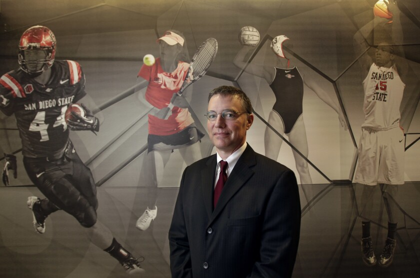 New Aztecs' Athletic Director John David Wicker takes over at a critical time in the school's sports history.