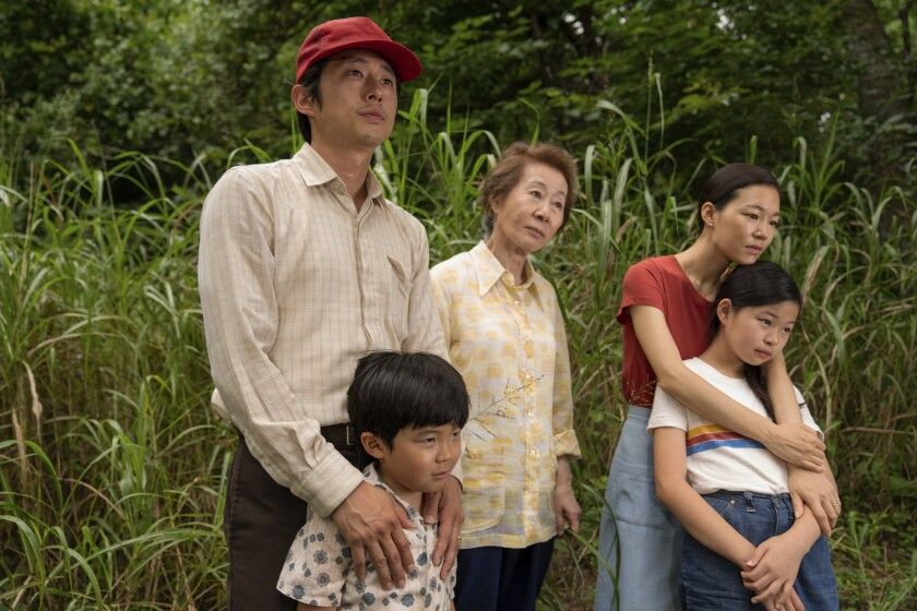 """This image released by A24 shows, from left, Steven Yeun, Alan S. Kim, Yuh-Jung Youn, Yeri Han, and Noel Cho in a scene from """"Minari."""" (Josh Ethan Johnson/A24 via AP)"""