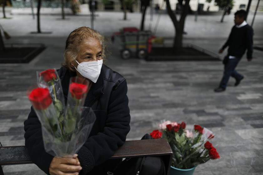 Martha Gonzalez Reyes, 76, sells roses in central Mexico City.