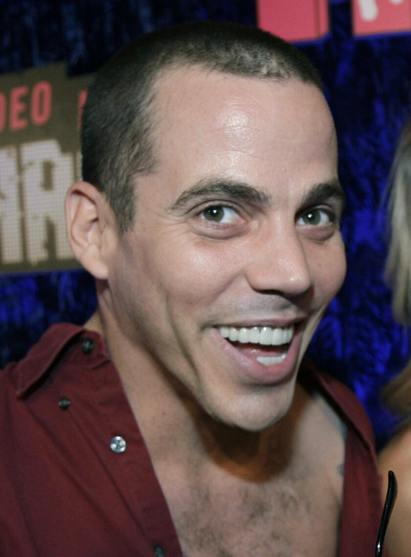 """FILE - This Sept. 9, 2007 file photo Steve-O and guest arrive at the MTV Video Music Awards at the Palms Hotel and Casino in Las Vegas. """"Jackass"""" star Steve-O will face five criminal charges after he climbed a crane in Hollywood to protest SeaWorld and drew dozens of emergency responders to a construction site earlier this month. (AP Photo/Kevork Djansezian, File)"""