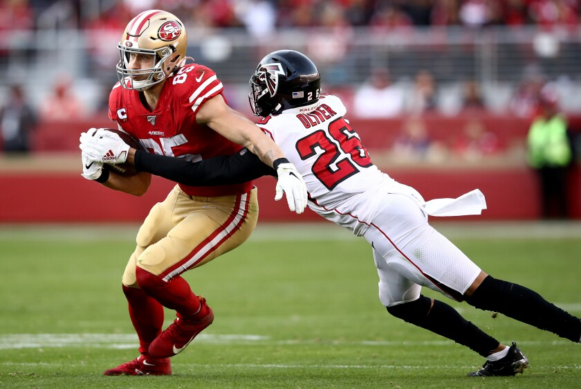 Falcons cornerback Isaiah Oliver tries to tackle 49ers tight end George Kittle on Dec. 15, 2019.