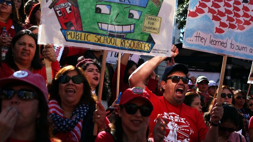 Thousands of striking Los Angeles Unified teachers gather in front of Los Angeles City Hall on Tuesd