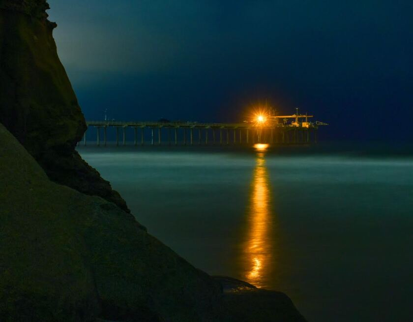 Scripps graduate student Nicholas DeNezzo took this image of bioluminescence lighting up the ocean Wednesday night at the Scripps Pier.