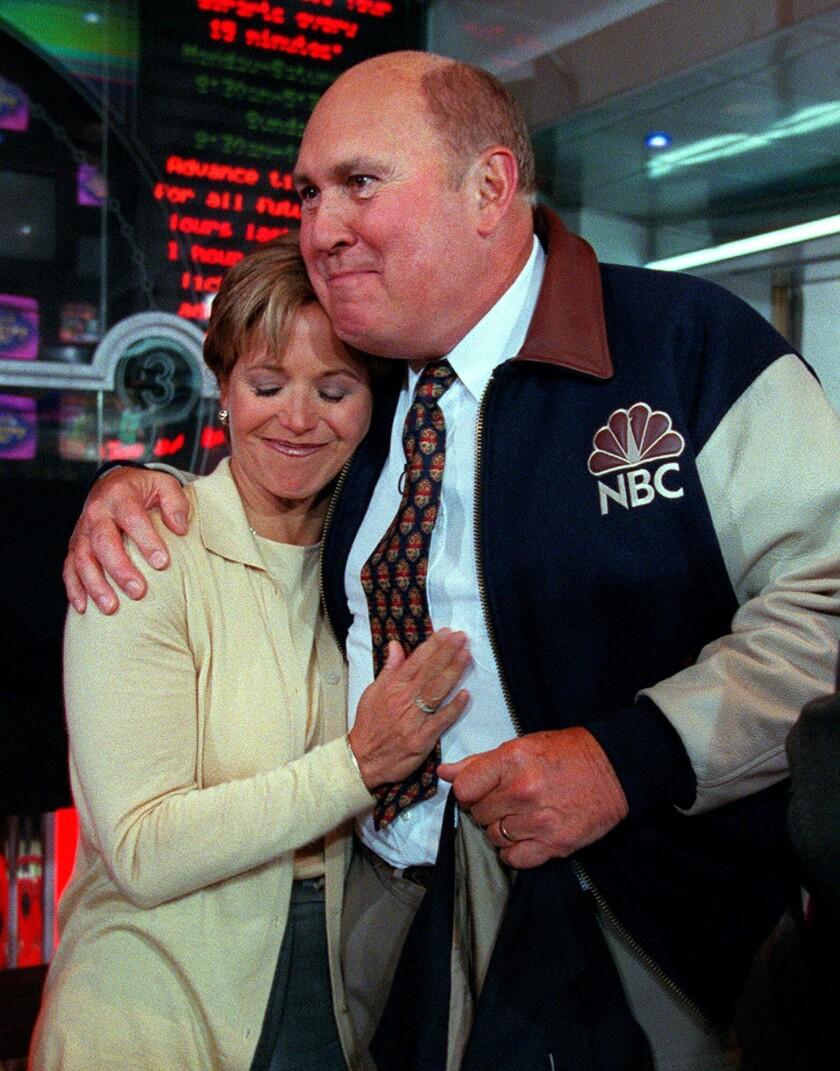 Willard Scott, right, hugs Today show colleague Katie Couric