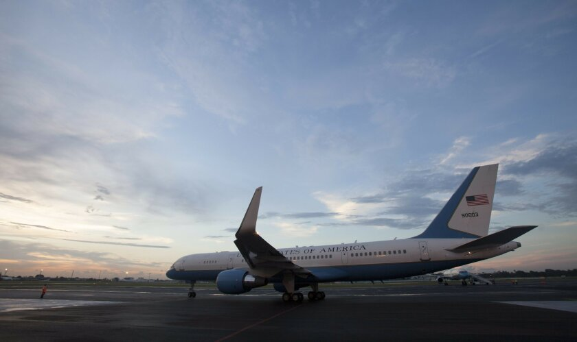 FILE - In this Aug. 14, 2015 file photo, the airplane carrying U.S. Secretary of State John Kerry prepares to depart the airport in Havana, Cuba, after the reopening of the U.S. Embassy after 54 years of broken diplomatic relations. The United States and Cuba will sign an agreement in late Feb. 201