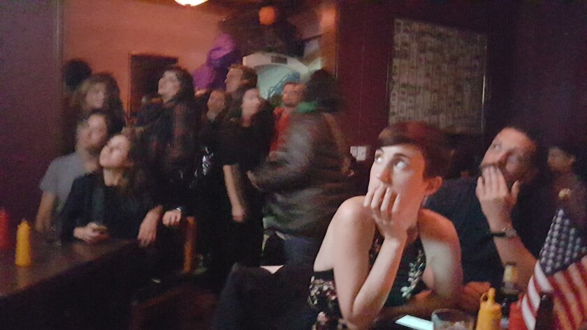 Patrons at a Mexico City bar react to Donald Trump's surprise victory Nov. 8.