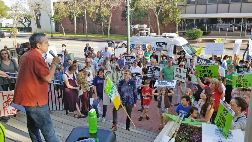 Dan Brotman, an economics professor at Glendale Community College, speaks to a crowd of more than 200 who rallied in front of Glendale City Hall Tuesday over a proposed renovation of the Grayson Power Plant in Glendale. Brotman formed the Glendale Environmental Coalition.