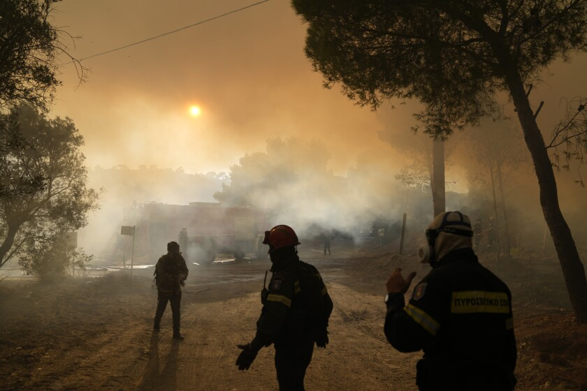 Firefighters operate during a wildfire in Siderina village about 55 kilometers (34 miles) south of Athens, Greece, Monday, Aug. 16, 2021. Two new big wildfires fanned by strong winds erupted Monday in hard-hit Greece, triggering evacuation alerts for villages southeast and northwest of Athens — days after blazes consumed large tracts of forest to the capital's north. (AP Photo/Thanassis Stavrakis)