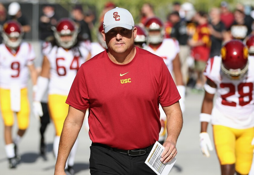 USC coach Clay Helton leads his players onto the field before a game against Arizona State on Nov. 9.
