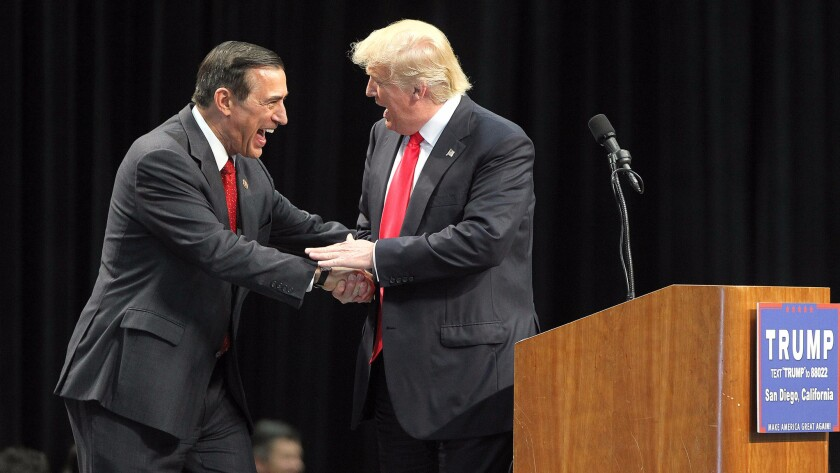 Rep. Darrell Issa (R-Vista), left, greets then-Republican presidential candidate Donald Trump during a campaign rally at the San Diego Convention Center on May 27.