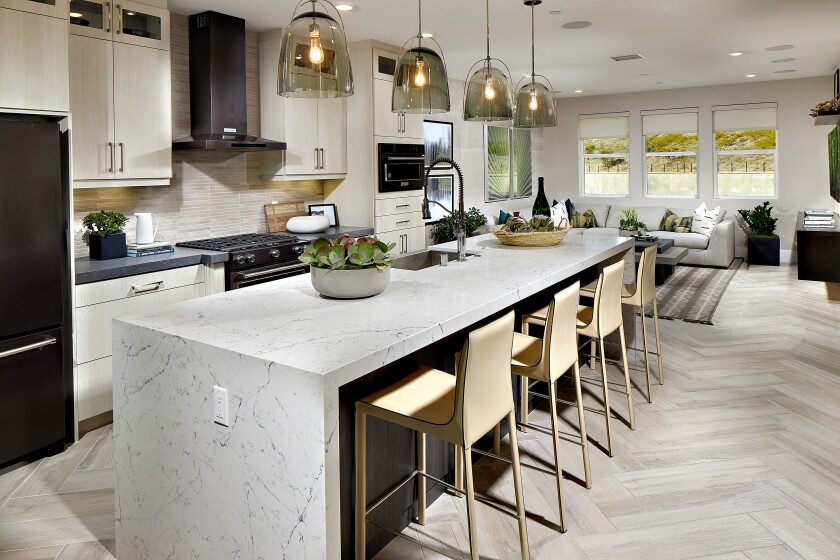 The Avella townshomes feature gourmet kitchens with quartz counters and large islands.