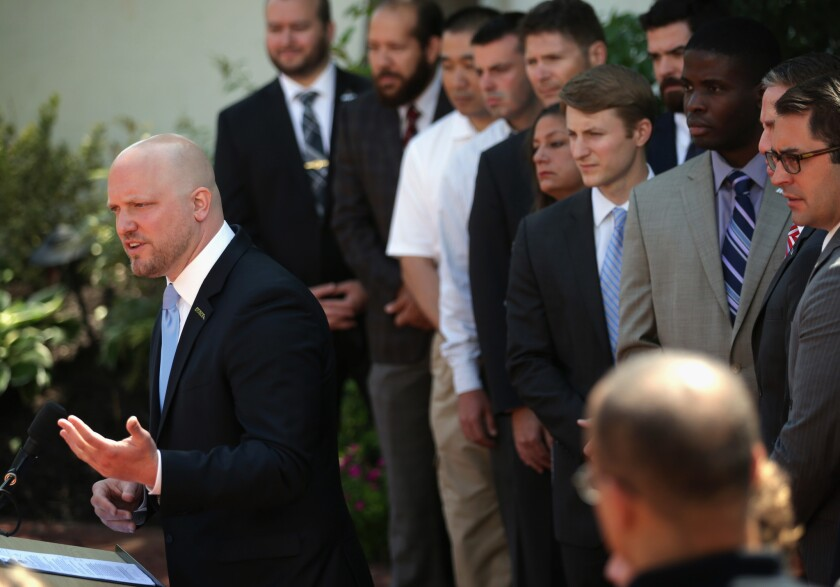 "Flanked by veterans, Paul Rieckhoff, founder and chief executive of Iraq and Afghanistan Veterans of America (IAVA), speaks at a news conference in Washington on Monday, during which he called on President Obama to ""move quickly to create and execute a bold, comprehensive plan to support all generations of American veterans"" while the nation is still focusing on the Veterans Affairs Department scandal."