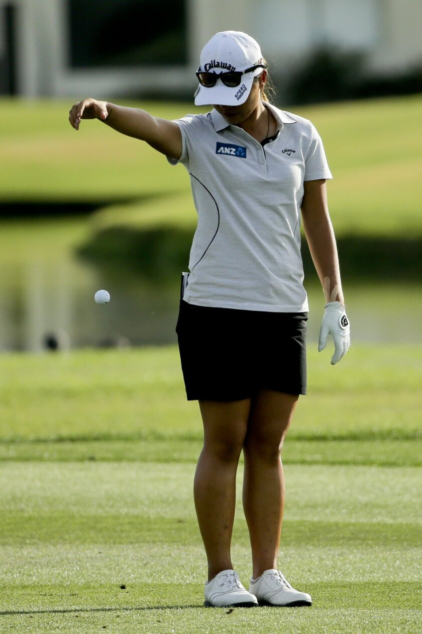 Lydia Ko, of New Zealand, takes a drop after hitting her ball in the water on the 18th hole during the second round of the LPGA Tour ANA Inspiration golf tournament at Mission Hills Country Club Friday, April 3, 2015 in Rancho Mirage, Calif. (AP Photo/Chris Carlson)