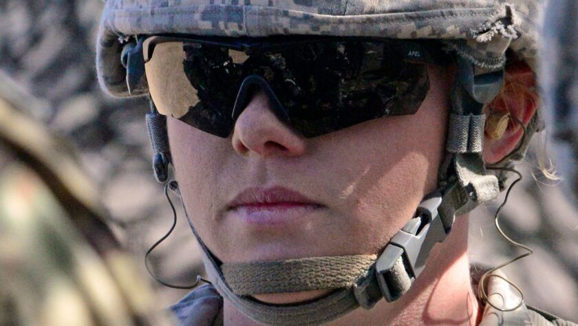 Pfc. Katherine Beatty is the U S. military's first female 13B cannon crewmember. New high physical