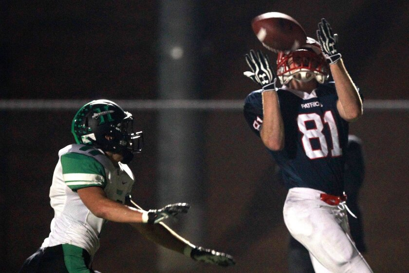 Christian receiver Kai Arvan catches a pass for one of three touchdowns he scored against Hilltop.