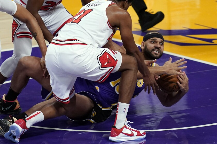 Lakers forward Jared Dudley asks for a timeout after grabbing a loose ball against the Bulls.