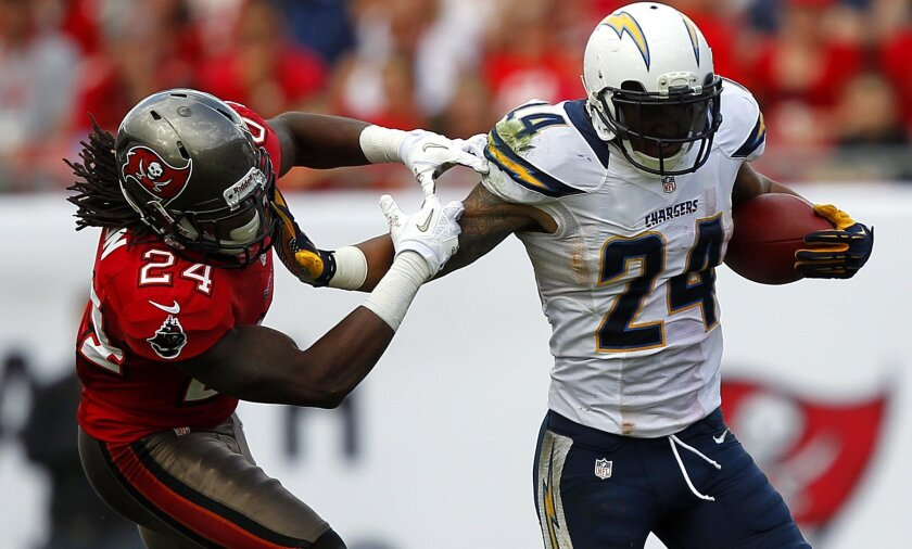 Chargers Ryan Mathews runs by Tampa Bay's Mark Barron in the 3rd quarter.