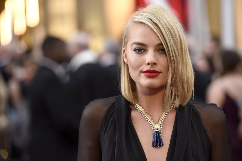 Margot Robbie arrives at the Oscars on Sunday, Feb. 22, 2015, at the Dolby Theatre in Los Angeles. (Photo by Chris Pizzello/Invision/AP)