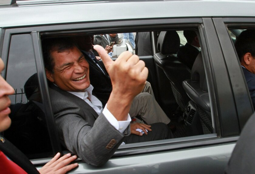 FOR USE AS DESIRED, YEAR END PHOTOS - FILE - President Rafael Correa gives a thumbs-up as he leaves a polling station after voting in Quito, Ecuador, Sunday, Feb. 17, 2013. Ecuadoreans were electing president, vice-president and National Assembly members with Correa highly favored to win a second re-election. (AP Photo/Martin Jaramillo, File)