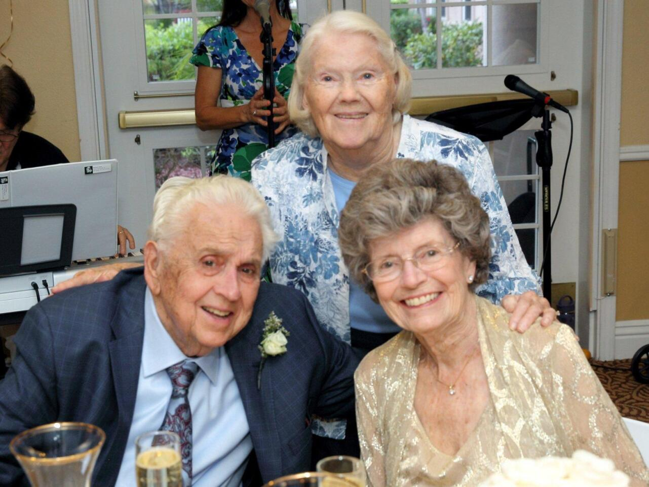 Newlyweds Hugh Foreman and Doris Swanlund (front) with Gloria Brewster,