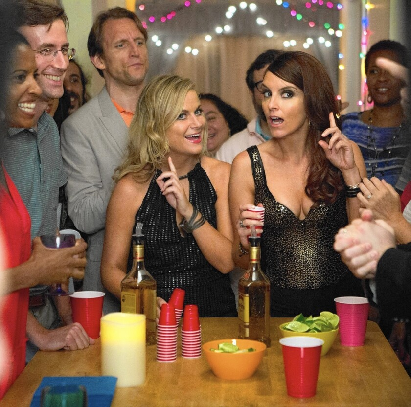 """Amy Poehler, left, and Tina Fey in """"Sisters."""""""
