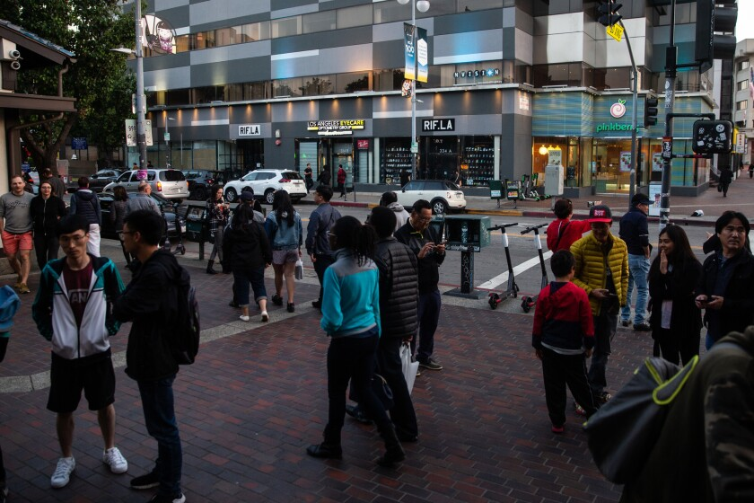 LOS ANGELES, CALIF. - MAY 17: People congregate and walk along 2nd street near the Little Tokyo Japa