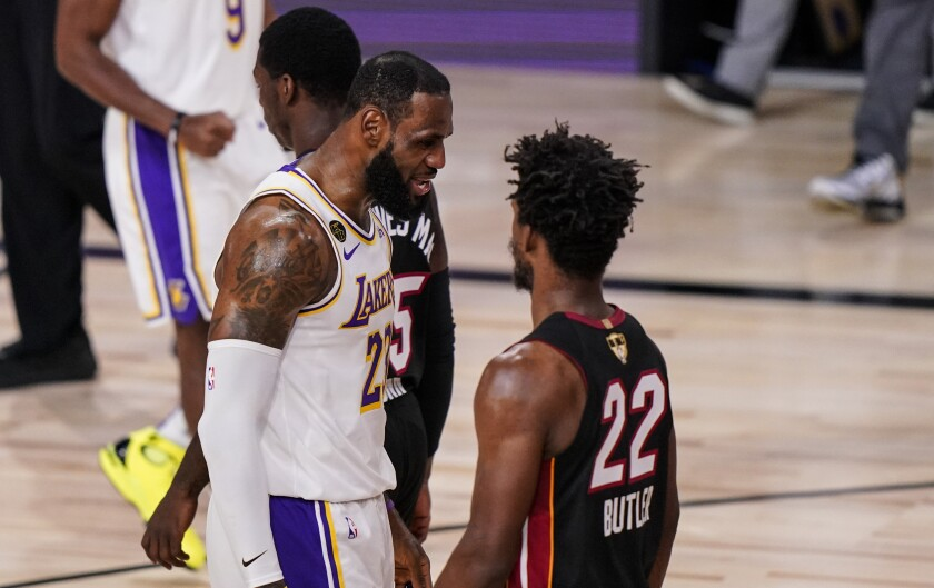 Lakers forward LeBron James and Heat star Jimmy Butler exchange some words during Game 3 of the NBA Finals on Sunday night.