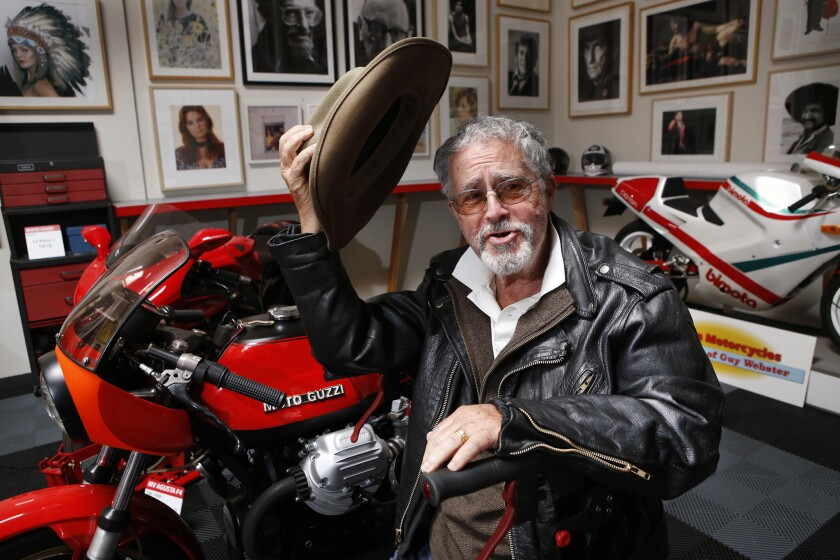 Guy Webster, in his Ojai studio, is surrounded by his favorite motorcycles and pictures he took of his favorite Hollywood stars.