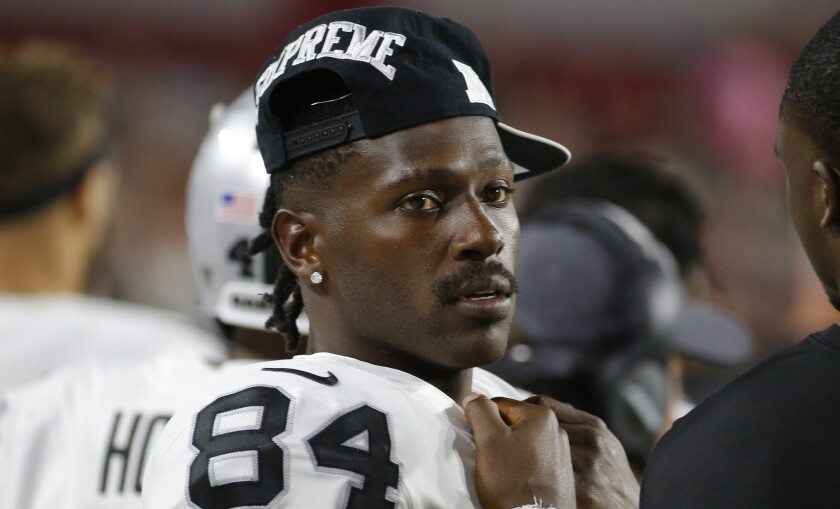Oakland Raiders wide receiver Antonio Brown stands on the sideline during a game against the Arizona Cardinals on Aug.15.