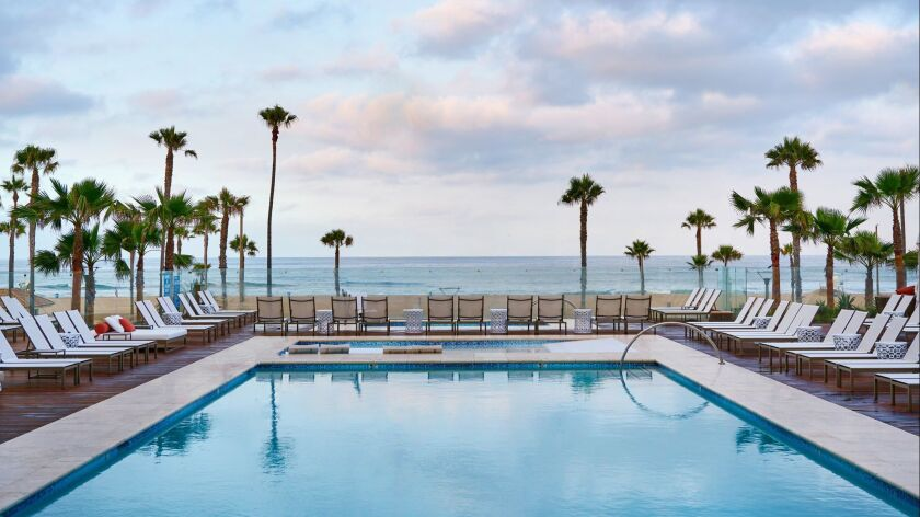 The Dawn Pool with a view of the coast at the Pas?a Hotel and Spa in Huntington Beach.