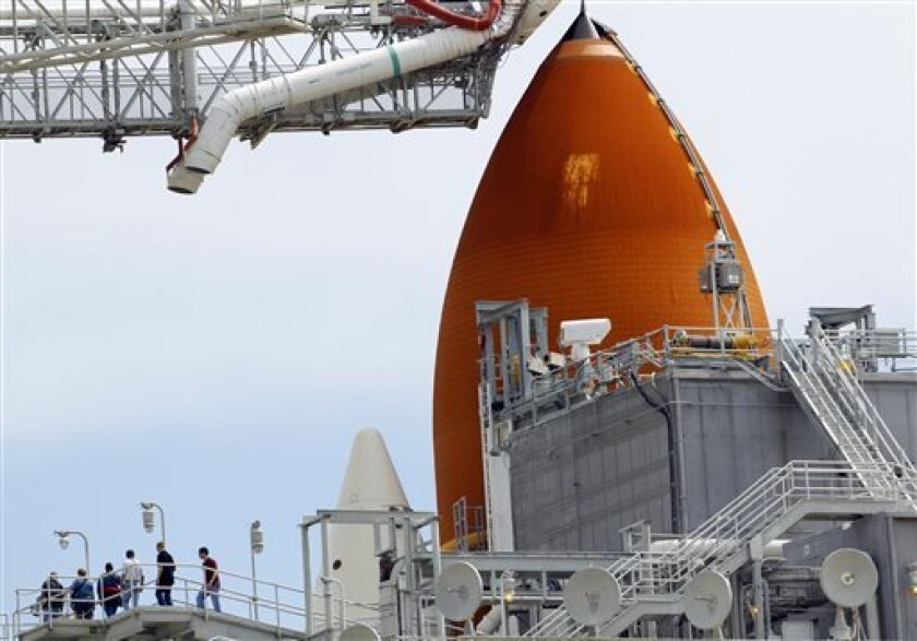 Workers make their way off the Rotating Service Structure at the Kennedy Space Center Thursday, July 7, 2011, in Cape Canaveral, Fla. The space shuttle Atlantis is scheduled to launch on Friday, July 8 and is the 135th and final space shuttle launch for NASA. (AP Photo/Dave Martin)