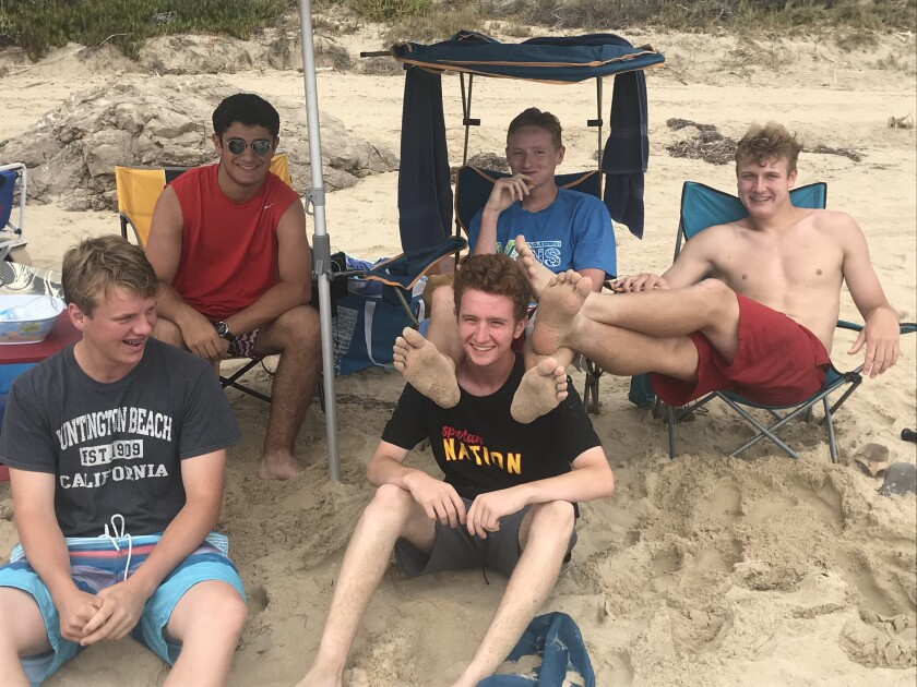 At 16, a good laugh with friends is everything. The boy (in footstool mode) and his buddies.