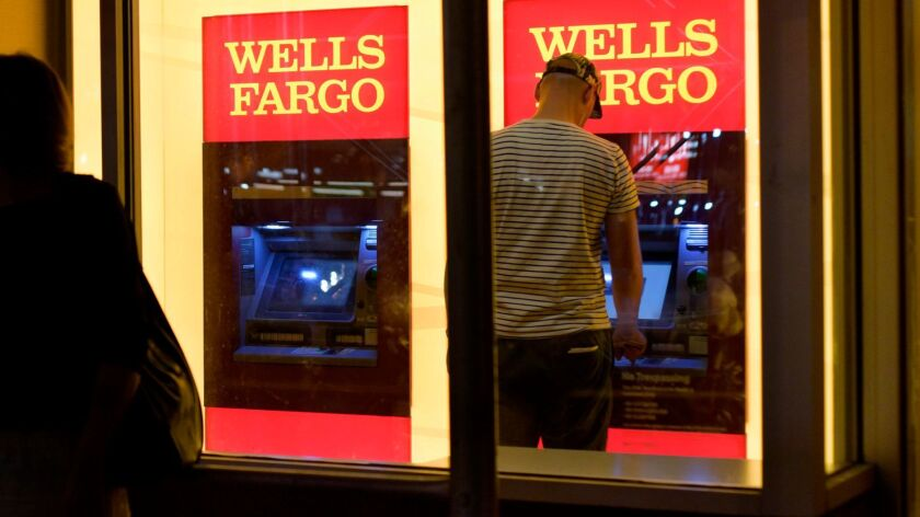 A customer uses a Wells Fargo ATM in New York in 2016.